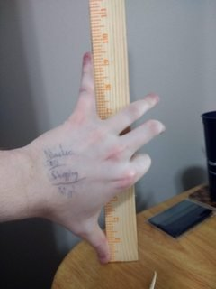 left hand next to ruler